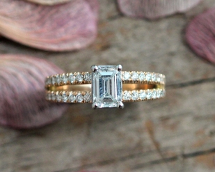 Custom split shank yellow gold and pave diamond ring with emerald cut center stone