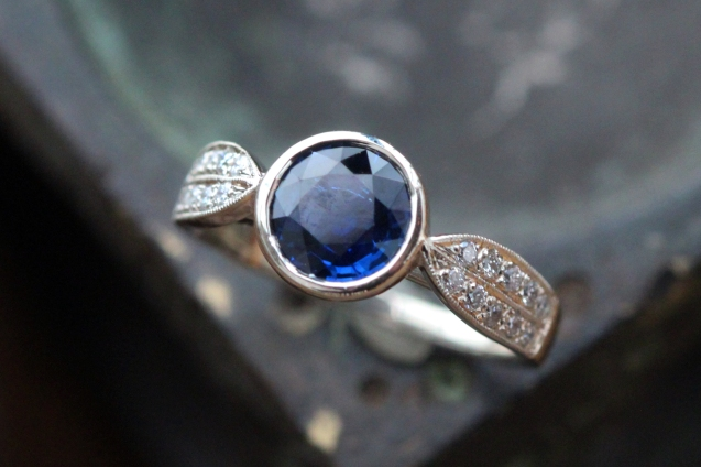 Blue sapphire leaf band with beadwork and tiny diamond details in white gold.