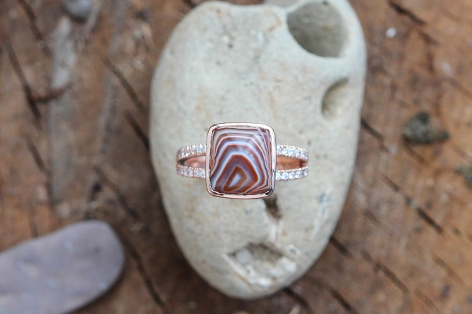 Custom Lake Superior Agate ring with pave diamond split shank band