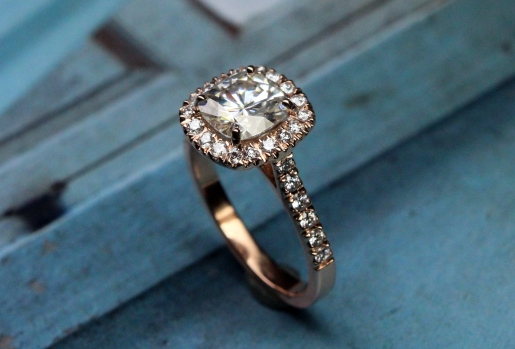 Custom rose gold halo with cushion cut moissanite center stone