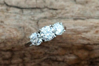 Three stone diamond ring in platinum