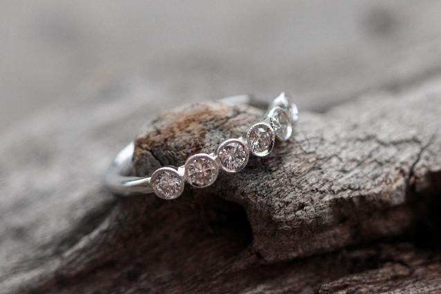 6 bezel diamond wedding band with milgrain edge detail.