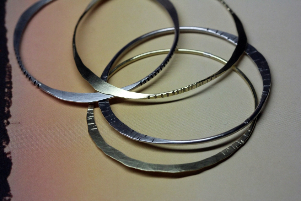 hammered and flattened bangles in brass, copper and silver