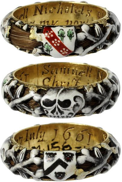 "Enameled gold mourning ring, English, 1661. The ring is hollow, and a lock of hair curls around within it, visible through the openwork of the enamelled decoration of skulls and coats of arms. There are two coats of arms, one for Nicholets, of Herefordshire. Inscribed inside ""Samuell Nicholets obijt [died] 17 July (1661) Christ is my portion""."