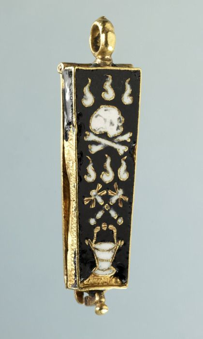 A French sixteenth-century memento-mori pendant featuring a skull and crossbones, symbols of death.