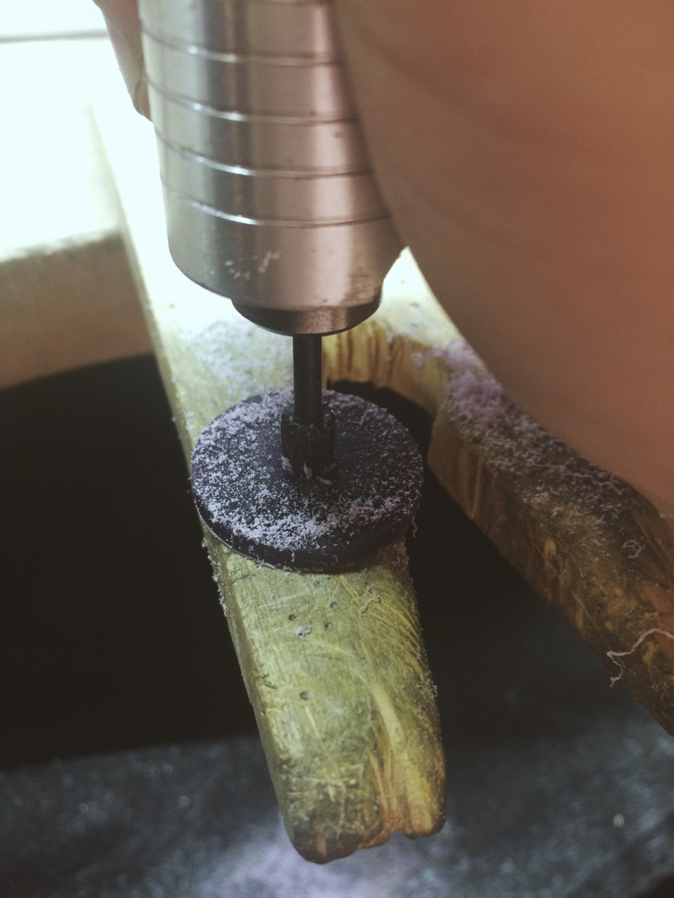 I like to do this holding the flex shaft perpendicular to the wax blank. Always hold onto your piece while drilling.