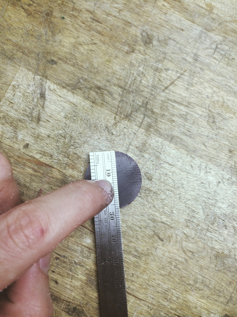 3. Figure out the middle point by dividing the diameter by two and marking that point with a scribe.