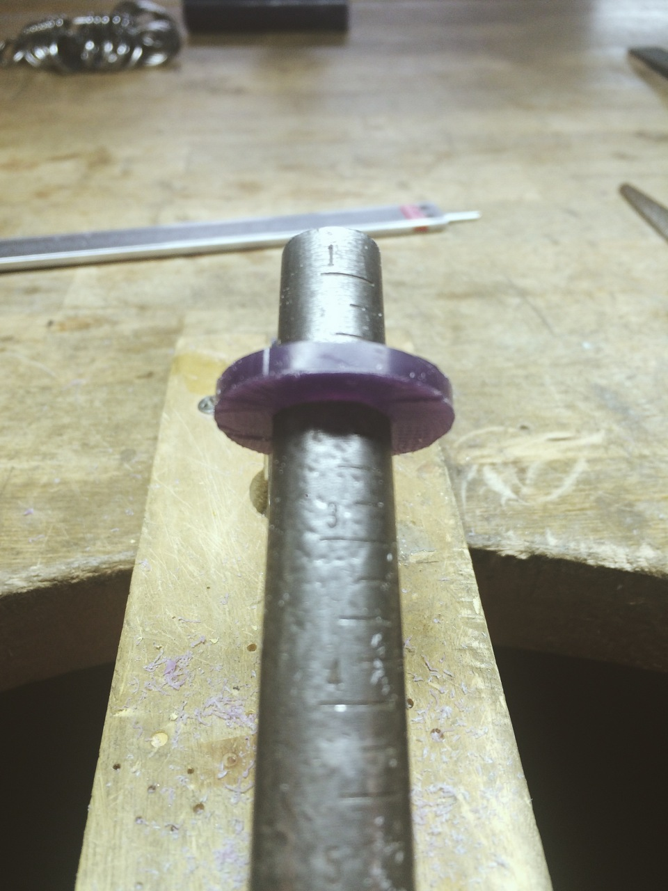 8. Using a ring mandrel, continuously check your work while opening up the size. Make sure to push the piece gently down the mandrel to ensure accurate sizing.