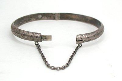 Antique oxidize bangle with chain lock closure.
