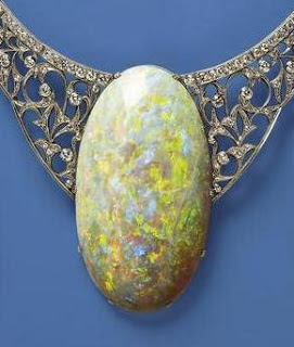 The Queen's Opal, given to Queen Elizabeth during one of her Australian Tours, weighs 203 carats and is set in 18K palladium.