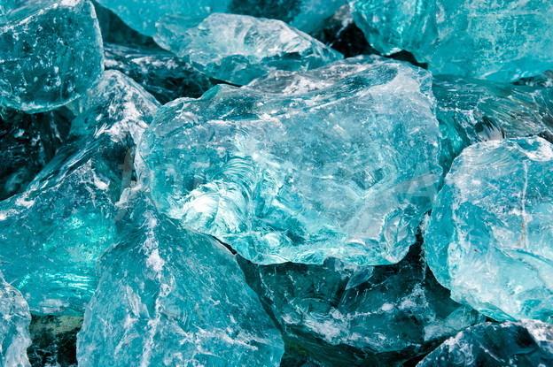 Raw aquamarine glass.